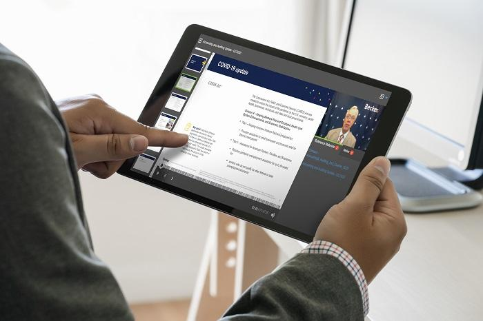 A person looks at the Becker site on a tablet